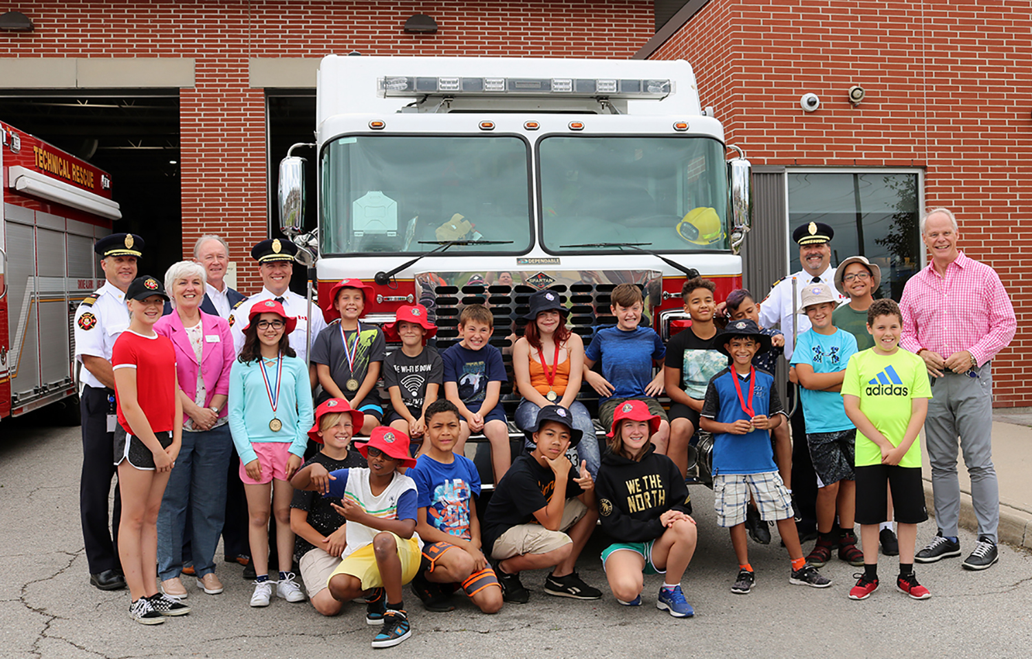 campers with fire staff and city council