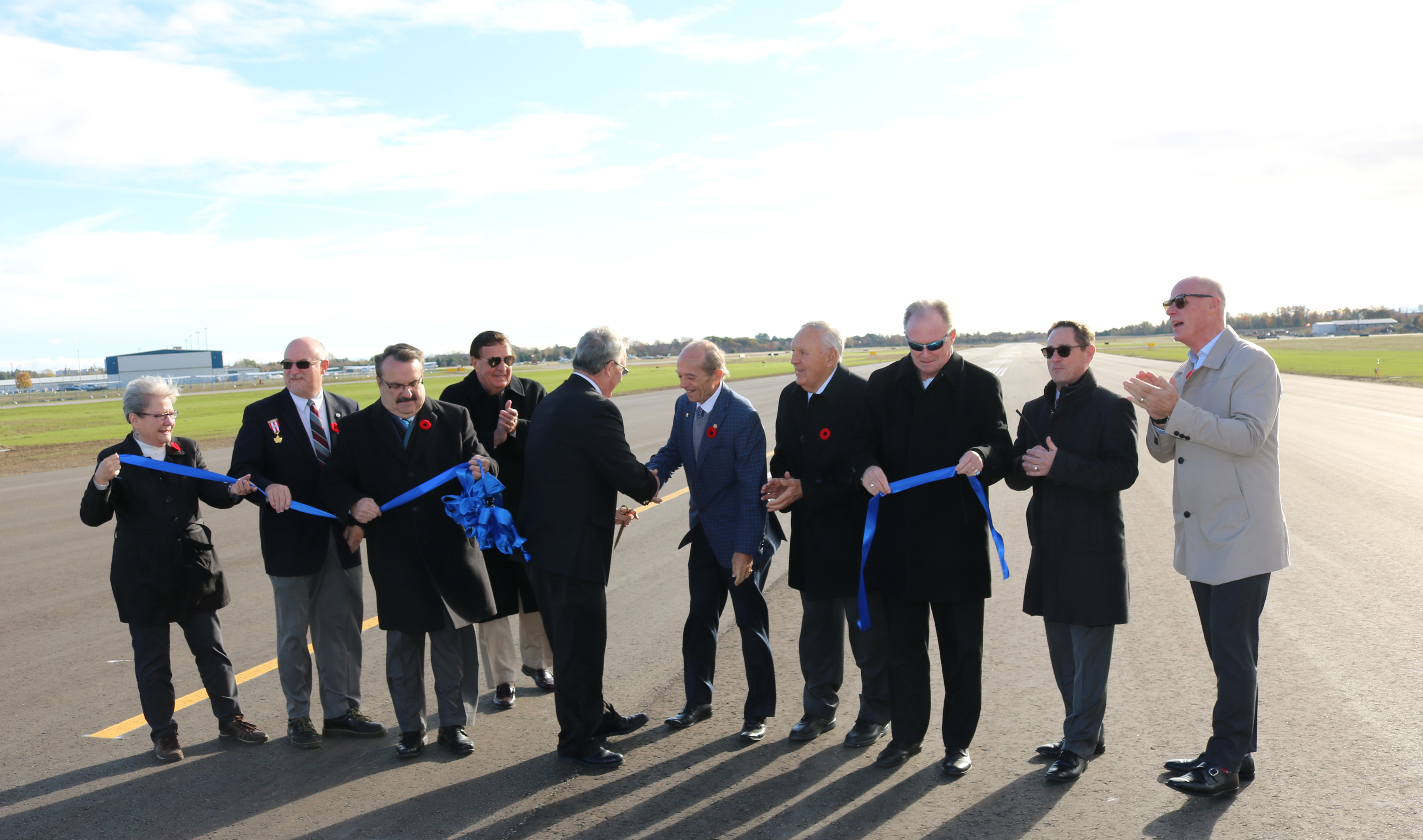 Ribbon-cutting to celebrate the official re-opening of the Oshawa Executive Airport runway